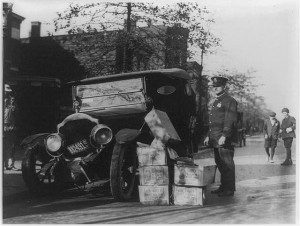 Policeman_and_wrecked_car_and_cases_of_moonshine