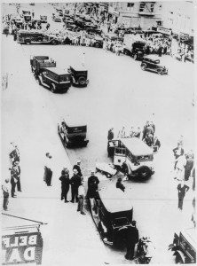 lossy-page1-445px-Bullet-riddled_taxi_and_the_bodies_of_two_gangsters_in_a_New_York_City_street_after_a_gun_battle_with_police,_1931_-_NARA_-_541879.tif